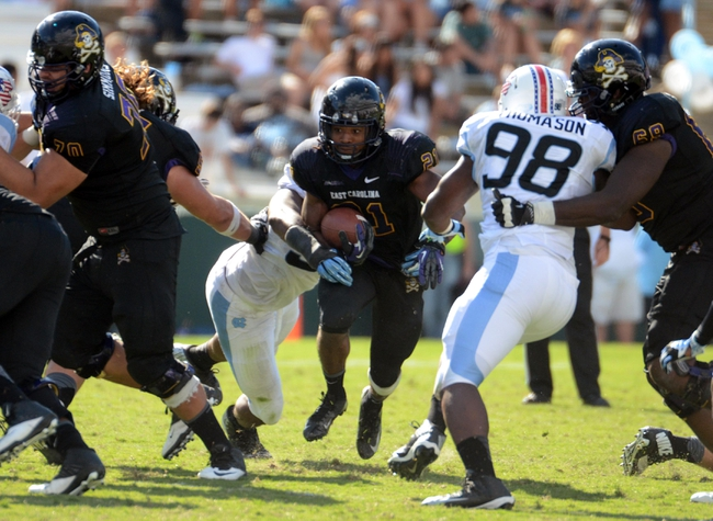 Sep 28, 2013; Chapel Hill, NC, USA; East Carolina Pirates running back Vontavious Cooper (21) runs the ball during the second half against the North Carolina Tarheels at Kenan Memorial Stadium.  ECU won 55-31. Mandatory Credit: Rob Kinnan-USA TODAY Sports