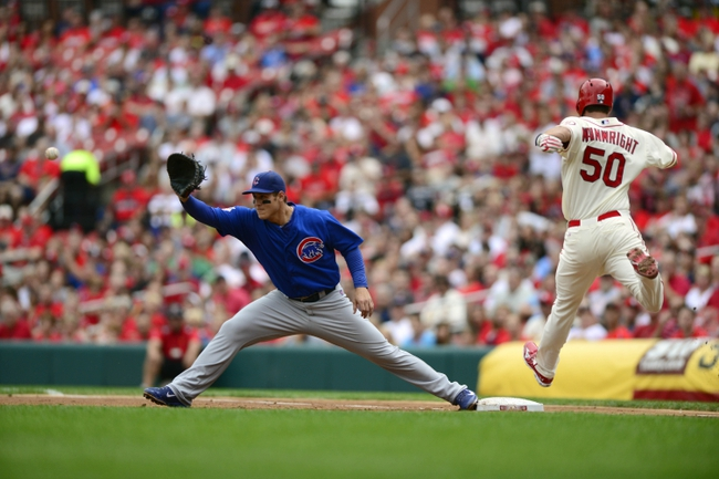Sep 28, 2013; St. Louis, MO, USA; Chicago Cubs first baseman Anthony Rizzo (44) stretches to force out St. Louis Cardinals starting pitcher Adam Wainwright (50) during the second inning at Busch Stadium. Mandatory Credit: Jeff Curry-USA TODAY Sports