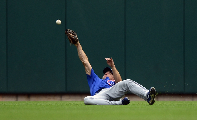 Sep 28, 2013; St. Louis, MO, USA; Chicago Cubs left fielder Brian Bogusevic (47) dives unsuccessfully for a ball hit by St. Louis Cardinals third baseman Daniel Descalso (not pictured) during the first inning at Busch Stadium. Mandatory Credit: Jeff Curry-USA TODAY Sports