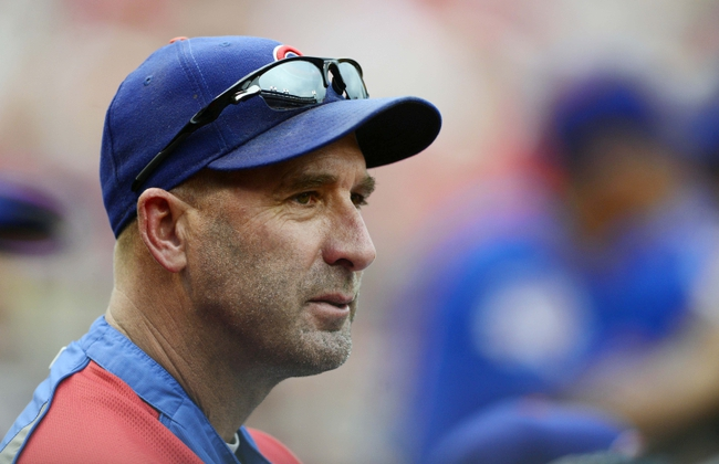 Sep 28, 2013; St. Louis, MO, USA; Chicago Cubs manager Dale Sveum (4) looks on as his team plays the St. Louis Cardinals during the third inning at Busch Stadium. Mandatory Credit: Jeff Curry-USA TODAY Sports