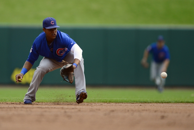 Sep 28, 2013; St. Louis, MO, USA; Chicago Cubs shortstop Starlin Castro (13) fields a ground ball hit by St. Louis Cardinals shortstop Pete Kozma (not pictured) during the first inning at Busch Stadium. Mandatory Credit: Jeff Curry-USA TODAY Sports