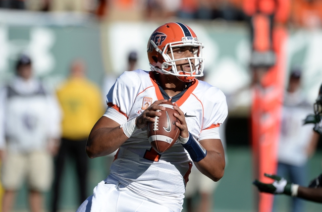 Sep 28, 2013; Fort Collins, CO, USA; UTEP Miners quarterback Jameill Showers (1) prepares to pass against the Colorado State Rams in the third quarter at Hughes Stadium. Mandatory Credit: Ron Chenoy-USA TODAY Sports