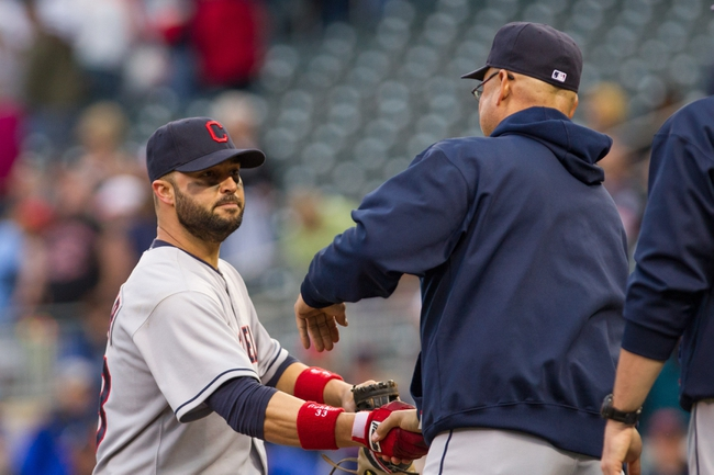 Sep 28, 2013; Minneapolis, MN, USA; Cleveland Indians first baseman Nick Swisher (33) gets a handshake from manager Terry Francona after their win against the Minnesota Twins  at Target Field. Mandatory Credit: Brad Rempel-USA TODAY Sports