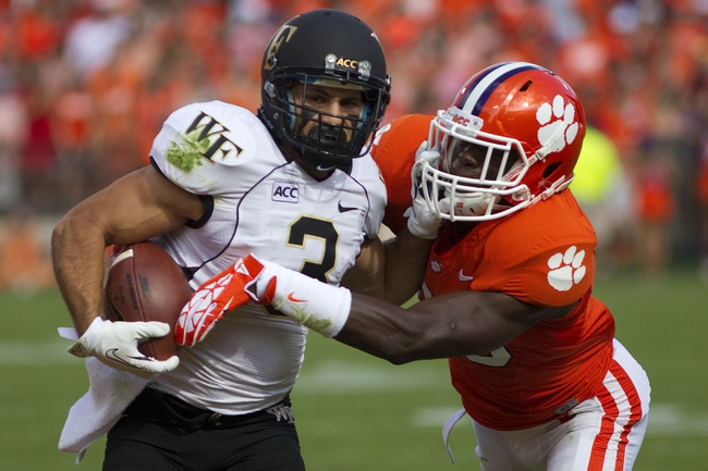 Sep 28, 2013; Clemson, SC, USA; Wake Forest Demon Deacons wide receiver Michael Campanaro (3) is defended by Clemson Tigers safety Jerrodd Williams (36) during the first quarter at Clemson Memorial Stadium. Tigers won 56-7. Mandatory Credit: Joshua S. Kelly-USA TODAY Sports