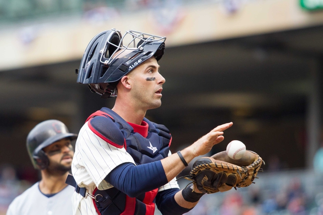 Sep 28, 2013; Minneapolis, MN, USA; Minnesota Twins catcher Eric Fryer (54) receives a new ball from the home plate umpire in the fourth inning against the Cleveland Indians at Target Field. Mandatory Credit: Brad Rempel-USA TODAY Sports