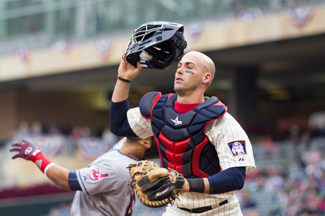 Sep 28, 2013; Minneapolis, MN, USA; Minnesota Twins catcher Eric Fryer (54) tracks down a foul ball in the fifth inning against the Cleveland Indians at Target Field. Mandatory Credit: Brad Rempel-USA TODAY Sports