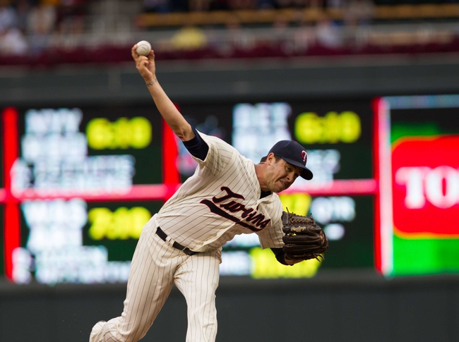 Sep 28, 2013; Minneapolis, MN, USA; Minnesota Twins pitcher Anthony Swarzak (51) delivers a pitch in the seventh inning against the Cleveland Indians at Target Field. Mandatory Credit: Brad Rempel-USA TODAY Sports