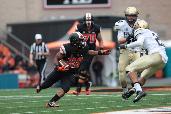 Sep 28, 2013; Corvallis, OR, USA; Colorado Buffaloes defensive back Jered Bell (21) defends against Oregon State Beavers running back Terron Ward (28) at Reser Stadium. Mandatory Credit: Scott Olmos-USA TODAY Sports
