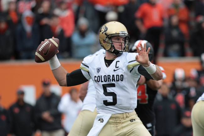 Sep 28, 2013; Corvallis, OR, USA; Colorado Buffaloes quarterback Connor Wood (5) throws the ball in the second half against the Oregon State Beavers at Reser Stadium. Mandatory Credit: Scott Olmos-USA TODAY Sports