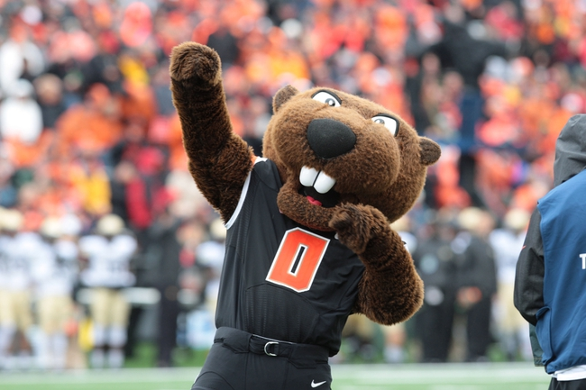 Sep 28, 2013; Corvallis, OR, USA; Oregon State Beavers mascot cheers the fans on while preforming at half time against the Colorado Buffaloes at Reser Stadium. Mandatory Credit: Scott Olmos-USA TODAY Sports