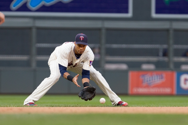 Sep 28, 2013; Minneapolis, MN, USA; Minnesota Twins shortstop Pedro Florimon (25) fields a ground ball in the sixth inning against the Cleveland Indians at Target Field. Mandatory Credit: Brad Rempel-USA TODAY Sports