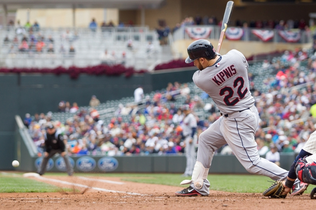 Sep 28, 2013; Minneapolis, MN, USA; Cleveland Indians second baseman Jason Kipnis (22) hits a single in the fifth inning against the Minnesota Twins at Target Field. Mandatory Credit: Brad Rempel-USA TODAY Sports