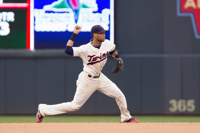Sep 28, 2013; Minneapolis, MN, USA; Minnesota Twins shortstop Pedro Florimon (25) throws to first base for the out in the seventh inning against the Cleveland Indians at Target Field. Mandatory Credit: Brad Rempel-USA TODAY Sports