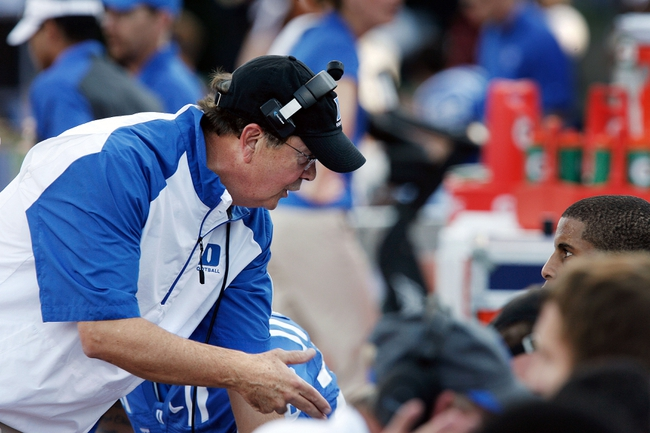 Sep 28, 2013; Durham, NC, USA;  Duke Blue Devils head coach David Cutcliffe talks to his players on the sidelines in their game against the Troy Trojans at Wallace Wade Stadium. Mandatory Credit: Mark Dolejs-USA TODAY Sports
