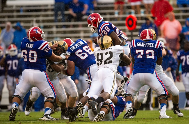 Sep 28, 2013; Dallas, TX, USA; Army Black Knights defensive lineman Mike Ugenyi (92) tackles Louisiana Tech Bulldogs running back Kenneth Dixon (28) during second quarter at the Cotton Bowl Stadium. Mandatory Credit: Jerome Miron-USA TODAY Sports