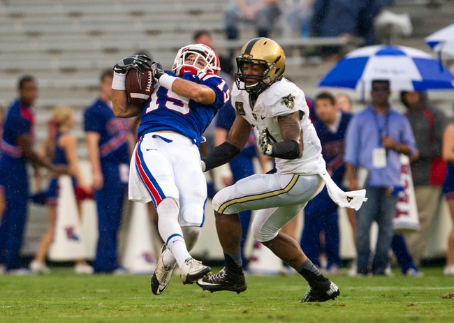 Sep 28, 2013; Dallas, TX, USA; Louisiana Tech Bulldogs wide receiver Andrew Guillot (19) makes a catch in front of Army Black Knights defensive back Marques Avery (4) during second quarter against the Army Black Knights at the Cotton Bowl Stadium. Mandatory Credit: Jerome Miron-USA TODAY Sports