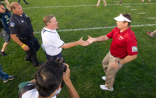 Sep 28, 2013; South Bend, IN, USA; Notre Dame Fighting Irish head coach Brian Kelly and Oklahoma Sooners head coach Bob Stoops shake hands after Oklahoma defeated Notre Dame 35-21 at Notre Dame Stadium. Mandatory Credit: Matt Cashore-USA TODAY Sports