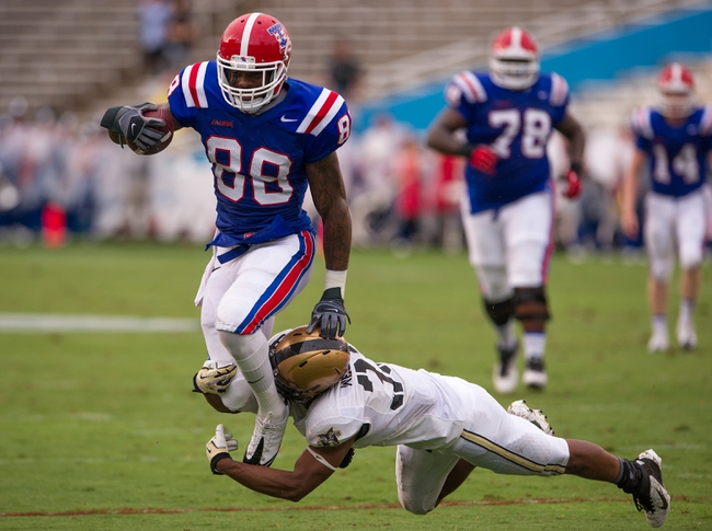 Sep 28, 2013; Dallas, TX, USA; Louisiana Tech Bulldogs wide receiver Eddie Johnson (88) jumps over Army Black Knights linebacker Tyler McLees (33) during second quarter at the Cotton Bowl Stadium. Mandatory Credit: Jerome Miron-USA TODAY Sports