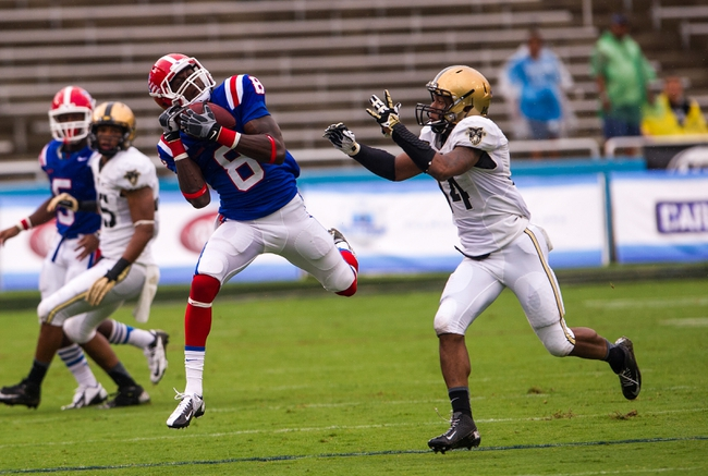 Sep 28, 2013; Dallas, TX, USA; Louisiana Tech Bulldogs wide receiver Jacarri Jackson (8) catches a pass in front of Army Black Knights defensive back Steven Johnson (14) during second quarter at the Cotton Bowl Stadium. Mandatory Credit: Jerome Miron-USA TODAY Sports