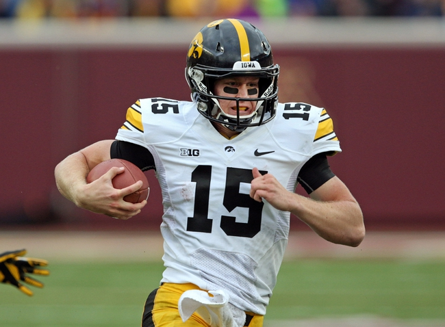 Sep 28, 2013; Minneapolis, MN, USA; Iowa Hawkeyes quarterback Jake Rudock (15) runs with the ball in the second half against the Minnesota Golden Gophers at TCF Bank Stadium. The Hawkeyes won 23-7. Mandatory Credit: Jesse Johnson-USA TODAY Sports