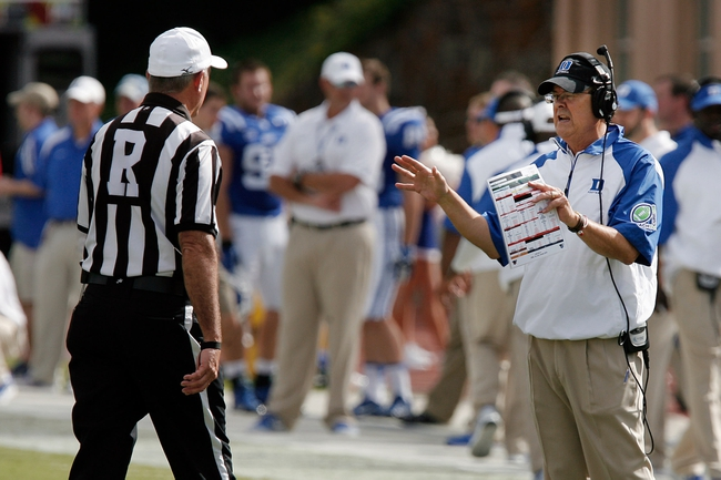 Sep 28, 2013; Durham, NC, USA; Duke Blue Devils head coach David Cutcliffe talks to an official in their game against the Troy Trojans at Wallace Wade Stadium. Mandatory Credit: Mark Dolejs-USA TODAY Sports