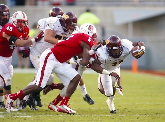 September 28, 2013; Raleigh, NC, USA; Central Michigan running back Maurice Shoemaker-Gilmore (11) is tackled by the North Carolina State linebacker Rodman Noel (5) at Carter Finley Stadium. North Carolina State defeated Central Michigan 48-14. Mandatory Credit: James Guillory-USA TODAY Sports