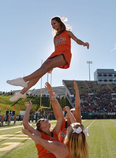 Sep 28, 2013; Fort Collins, CO, USA; Colorado State Rams cheerleaders perform during the game against the UTEP Miners at Hughes Stadium. The Rams defeated the Miners 59-42. Mandatory Credit: Ron Chenoy-USA TODAY Sports