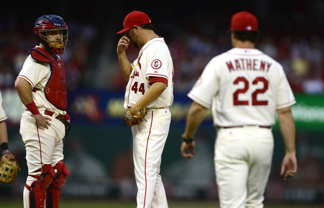 Sep 28, 2013; St. Louis, MO, USA; St. Louis Cardinals relief pitcher Edward Mujica (44) is removed fro the game by manager Mike Matheny (22) during the ninth inning at Busch Stadium. St. Louis defeated Chicago 6-2. Mandatory Credit: Jeff Curry-USA TODAY Sports