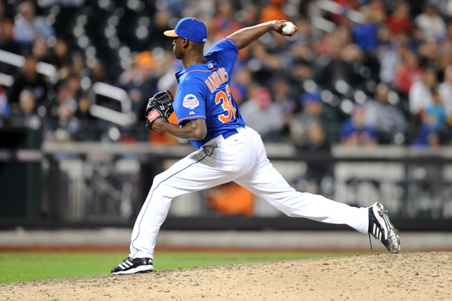 Sep 28, 2013; New York, NY, USA; New York Mets relief pitcher LaTroy Hawkins (32) throws a pitch against the Milwaukee Brewers during the ninth inning at Citi Field. Mandatory Credit- Joe Camporeale-USA TODAY Sports