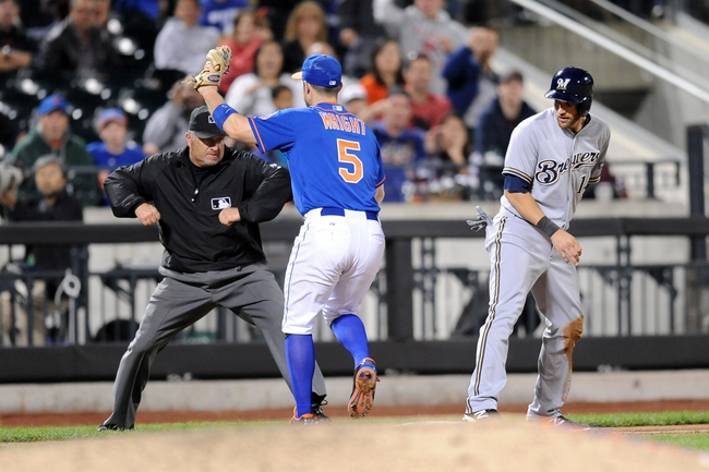 Sep 28, 2013; New York, NY, USA; Milwaukee Brewers third baseman Jeff Bianchi (14) is punched out after being caught stealing against the New York Mets at Citi Field. Mandatory Credit- Joe Camporeale-USA TODAY Sports