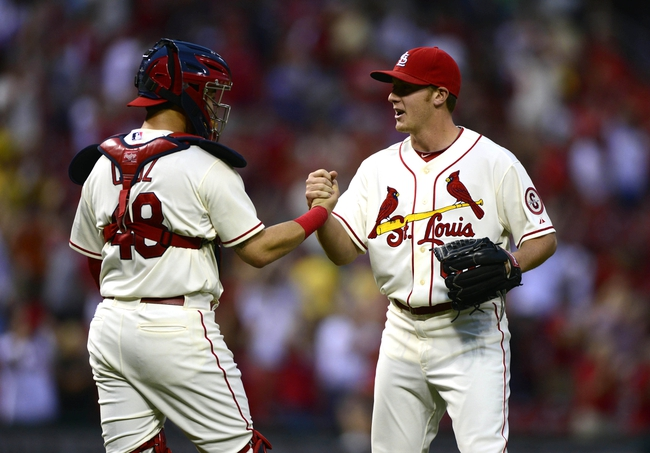 Sep 28, 2013; St. Louis, MO, USA; St. Louis Cardinals relief pitcher Seth Maness (61) celebrates with catcher Tony Cruz (48) after defeating the Chicago Cubs at Busch Stadium. St. Louis defeated Chicago 6-2. Mandatory Credit: Jeff Curry-USA TODAY Sports