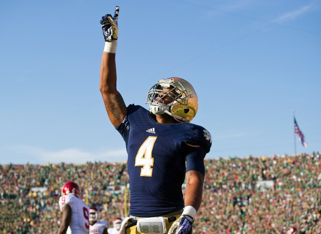 Sep 28, 2013; South Bend, IN, USA; Notre Dame Fighting Irish running back George Atkinson III (4) celebrates after scoring a touchdown in the third quarter against the Oklahoma Sooners at Notre Dame Stadium. Oklahoma won 35-21. Mandatory Credit: Matt Cashore-USA TODAY Sports