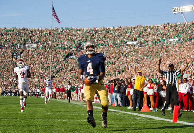 Sep 28, 2013; South Bend, IN, USA; Notre Dame Fighting Irish running back George Atkinson III (4) crosses the goal line for a touchdown in the third quarter against the Oklahoma Sooners at Notre Dame Stadium. Oklahoma won 35-21. Mandatory Credit: Matt Cashore-USA TODAY Sports