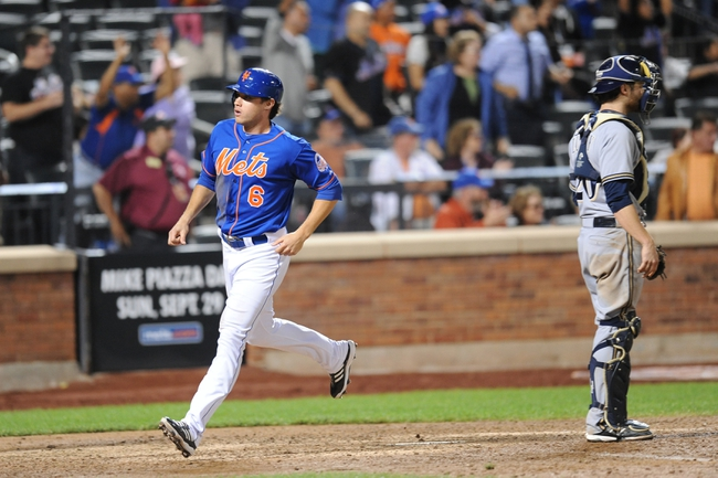 Sep 28, 2013; New York, NY, USA; New York Mets center fielder Matt den Dekker (6) scores a run after being driven in by New York Mets left fielder Eric Young Jr. (not pictured) during the ninth inning against the Milwaukee Brewers at Citi Field. Mandatory Credit- Joe Camporeale-USA TODAY Sports