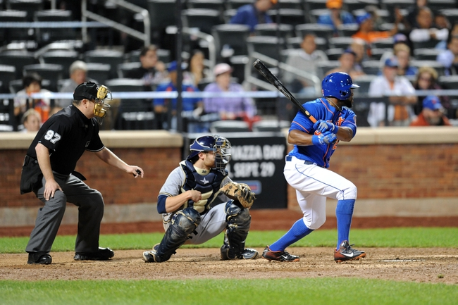 Sep 28, 2013; New York, NY, USA; New York Mets left fielder Eric Young Jr. (22) hits an RBI single in the ninth inning against the Milwaukee Brewers at Citi Field. Mandatory Credit- Joe Camporeale-USA TODAY Sports