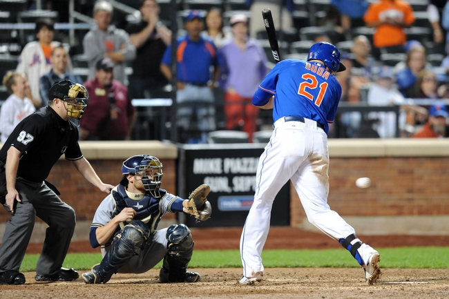 Sep 28, 2013; New York, NY, USA; New York Mets left fielder Lucas Duda (21) is hit by a pitch during the ninth inning against the Milwaukee Brewers at Citi Field. Mandatory Credit- Joe Camporeale-USA TODAY Sports
