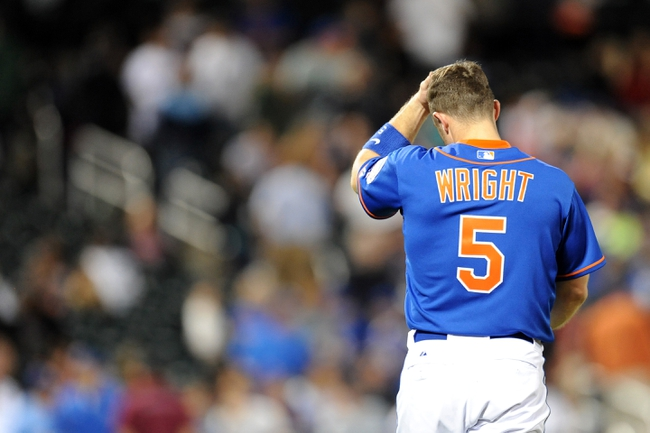 Sep 28, 2013; New York, NY, USA; New York Mets third baseman David Wright (5) reacts after grounding into an inning-ending double play in the ninth inning against the Milwaukee Brewers at Citi Field. Mandatory Credit- Joe Camporeale-USA TODAY Sports
