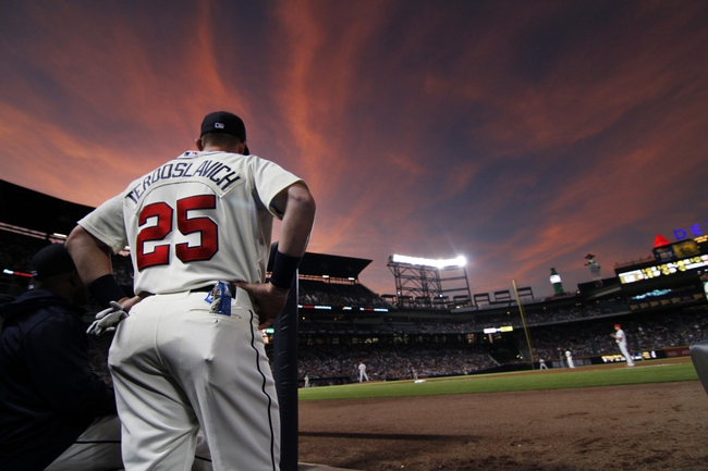 Sep 28, 2013; Atlanta, GA, USA; Atlanta Braves left fielder Joey Terdoslavich (25) watches a game against the Philadelphia Phillies in the first inning at Turner Field. Mandatory Credit: Brett Davis-USA TODAY Sports