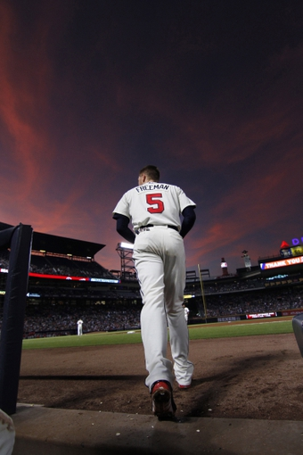 Sep 28, 2013; Atlanta, GA, USA; Atlanta Braves first baseman Freddie Freeman (5) runs on the field between innings against the Philadelphia Phillies after the first inning at Turner Field. Mandatory Credit: Brett Davis-USA TODAY Sports