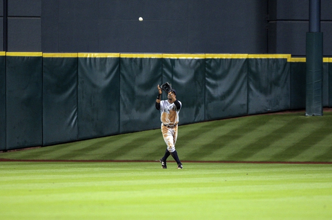 Sep 28, 2013; Houston, TX, USA; New York Yankees center fielder Curtis Granderson (14) catches a fly ball during the second inning against the Houston Astros at Minute Maid Park. Mandatory Credit: Troy Taormina-USA TODAY Sports