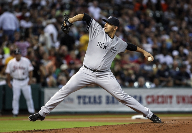 Sep 28, 2013; Houston, TX, USA; New York Yankees starting pitcher Andy Pettitte (46) pitches during the second inning against the Houston Astros at Minute Maid Park. Mandatory Credit: Troy Taormina-USA TODAY Sports