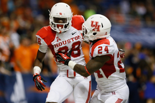 Sep 28, 2013; San Antonio, TX, USA; Houston Cougars wide receiver Xavier Maxwell (88) is congratulated by running back Kent Brooks (24)  after scoring a touchdown against the Texas-San Antonio Roadrunners during the second  half at Alamodome. Houston won 59 - 28. Mandatory Credit: Soobum Im-USA TODAY Sports