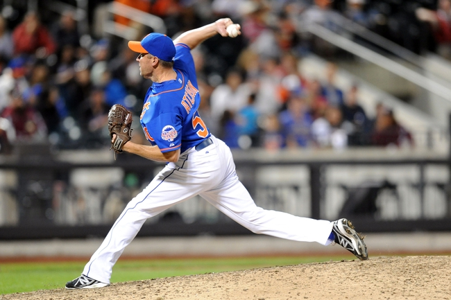 Sep 28, 2013; New York, NY, USA; New York Mets relief pitcher Scott Atchison (50) throws a pitch during the tenth inning against the Milwaukee Brewers at Citi Field. The Brewers won the game 4-2. Mandatory Credit- Joe Camporeale-USA TODAY Sports