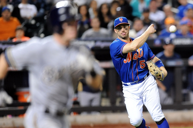 Sep 28, 2013; New York, NY, USA; New York Mets third baseman David Wright (5) throws out Milwaukee Brewers second baseman Scooter Gennett (2) at first base during the tenth inning at Citi Field. The Brewers won the game 4-2. Mandatory Credit- Joe Camporeale-USA TODAY Sports