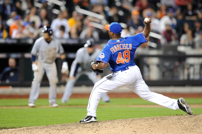 Sep 28, 2013; New York, NY, USA; New York Mets relief pitcher Frank Francisco (48) throws a pitch during the tenth inning against the Milwaukee Brewers at Citi Field. The Brewers won the game 4-2. Mandatory Credit- Joe Camporeale-USA TODAY Sports