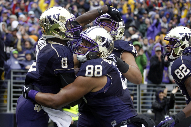 Sep 28, 2013; Seattle, WA, USA; Washington Huskies wide receiver Kevin Smith (8) celebrates a touchdown reception against the Arizona Wildcats with tight end Austin Seferian-Jenkins (88), offensive linesman Mike Criste (78) and tight end Joshua Perkins (82) during the first quarter at Husky Stadium. Mandatory Credit: Joe Nicholson-USA TODAY Sports