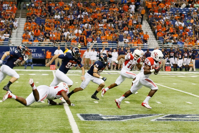 Sep 28, 2013; San Antonio, TX, USA; Houston Cougars defensive back Brandon Wilson (26) runs with a blocked field goal attempt by Texas-San Antonio Roadrunners kicker Sean Ianno (not pictured) during the second  half at Alamodome. Houston won 59 - 28. Mandatory Credit: Soobum Im-USA TODAY Sports