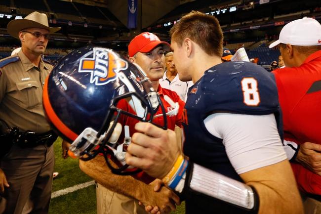 Sep 28, 2013; San Antonio, TX, USA; Houston Cougars head coach Tony Levine and Texas-San Antonio Roadrunners quarterback Eric Soza (8) shake hands after the game at Alamodome. Houston won 59 - 28. Mandatory Credit: Soobum Im-USA TODAY Sports