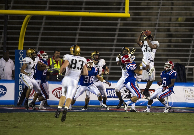 Sep 28, 2013; Dallas, TX, USA; Army Black Knights linebacker Tyler McLees (33) intercepts a pass by Louisiana Tech Bulldogs quarterback Ryan Higgins (not pictured) to end the game at the Cotton Bowl Stadium. The Black Knights defeated the Bulldogs 35-16. Mandatory Credit: Jerome Miron-USA TODAY Sports