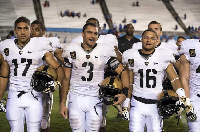 Sep 28, 2013; Dallas, TX, USA; Army Black Knights defensive back Tyler Dickson (17) and quarterback Angel Santiago (3) and quarterback Kelvin White (16) sing their alma mater after the win over the Louisiana Tech Bulldogs at the Cotton Bowl Stadium. The Black Knights defeated the Bulldogs 35-16. Mandatory Credit: Jerome Miron-USA TODAY Sports